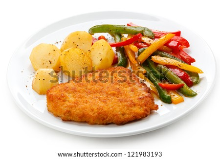 Pork chop, baked potatoes and vegetables - stock photo