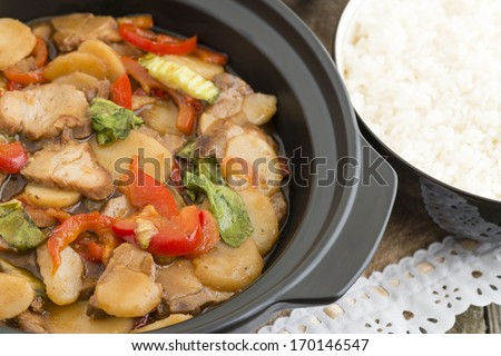 Pork Chop Suey - Chinese style stir-fry with pork and vegetables served with steamed rice. - stock photo