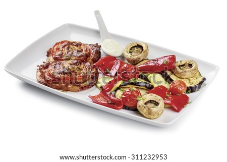 pork chop with grilled vegetables - stock photo