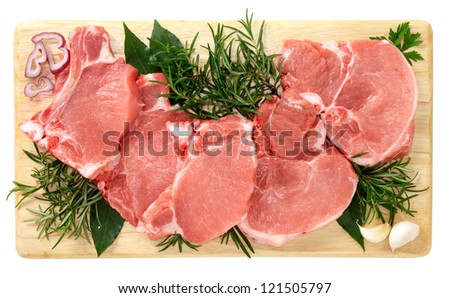 Pork chops on wooden board - stock photo