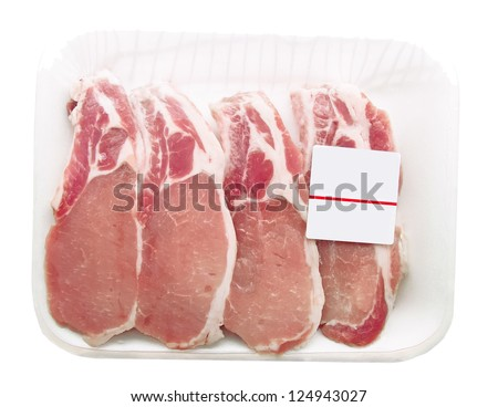 Pork chops packaged in a container with a price tag - stock photo
