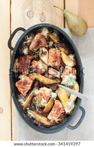 Pork chops with gorgonzola and pears - stock photo