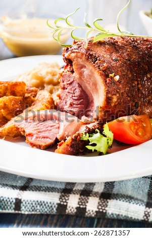 Pork knuckle with fried sauerkraut and salad - stock photo