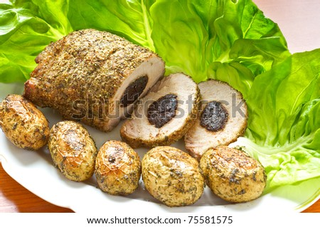Pork loin with dried plums - stock photo