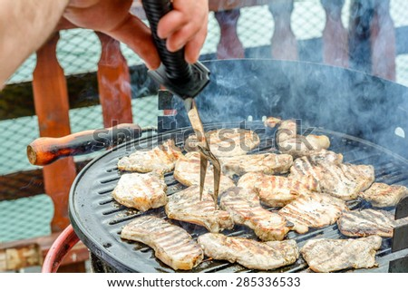 Pork meat chops on barbeque grill - stock photo