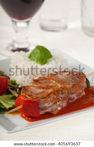 pork meat on skewers with rice  - stock photo