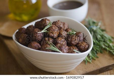 Pork meatballs with rosemary and gravy - stock photo