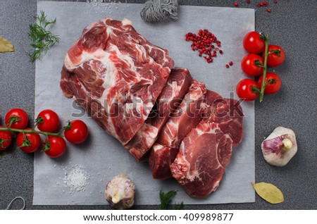 Pork neck entirely in parchment with vegetables and spices on top . Pork meat with vegetable. Organic pork meat. - stock photo
