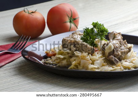 Pork ribs with cabbage  - stock photo