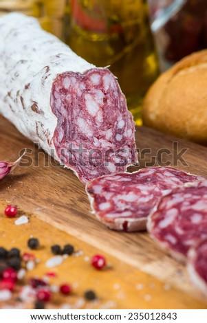 pork salami on wooden board - stock photo