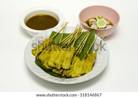 Pork Satay with Peanut Sauce (Thai street food) - stock photo