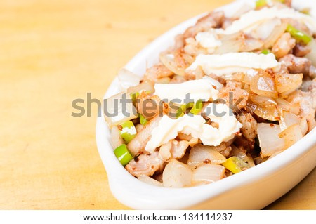 pork sisig a popular delicacy in the philippines - stock photo