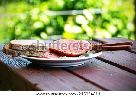pork steak with bread on wooden table, barbecue,grilling - stock photo