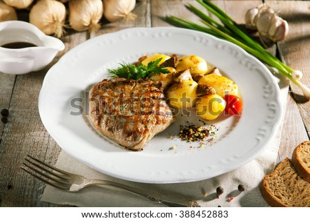 Pork Steak with Potato and Parsley - stock photo