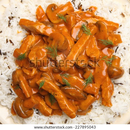 Pork stroganoff served with wild rice. - stock photo