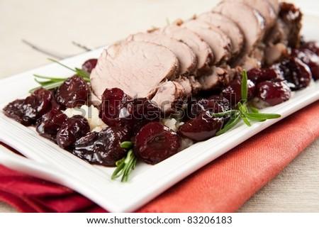 Pork Tenderloin with Cherry Sauce Served Over Mashed Cauliflower - stock photo