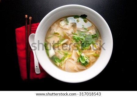 pork wontons in a clear broth with bok choy and ramen noodles - stock photo