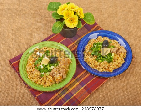 Porridge in a dish seasoned with chives - stock photo