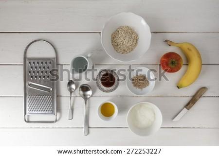 Porridge, oatmeal, apple, banana, yoghurt, honey, sesame seeds - stock photo