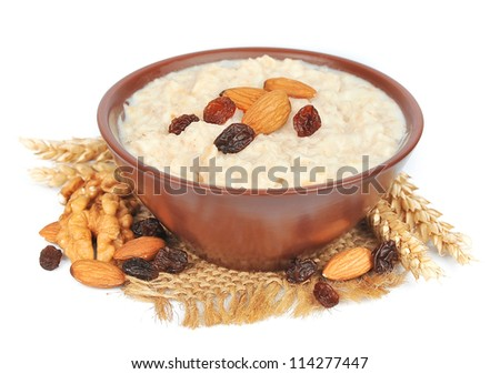 porridge with nuts of almonds, a walnut and raisin - stock photo
