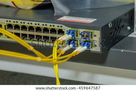 port and module of fiber optic cable for connection to Network Server . router and servers in a technology data center . selective focus - stock photo