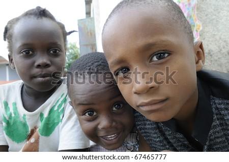 PORT-AU-PRINCE - SEPTEMBER 2:  unidentified Haitian kids  enjoying during a camp, in Port-Au-Prince, Haiti on September 2, 2010. - stock photo