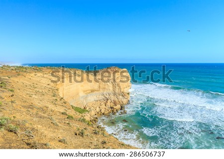 PORT CAMPBELL, AUSTRALIA - MAR 21, 2015: Tourists visit Twelve Apostles. It's a collection of limestone stacks off the shore of the Port Campbell, a famous tourist destination in Victoria. - stock photo