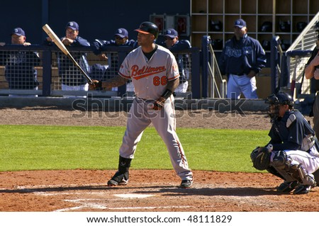 PORT CHARLOTTE, FLORIDA - MARCH 4: Josh Bell of the Baltimore Orioles bats during a game against the Tampa Bay Rays on March 4, 2010 in Port Charlotte, Florida - stock photo