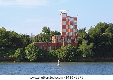 Port control tower building with radar device - stock photo