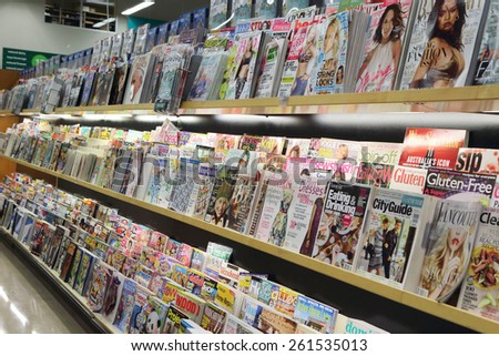 Port Coquitlam, BC Canada - March 17, 2015 : Magazine and cleaning product inside supermarket in Port Coquitlam BC Canada. - stock photo