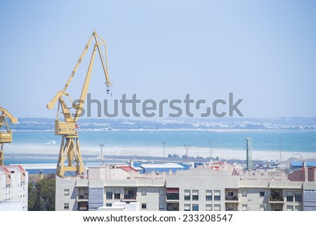 Port crane near at the city - stock photo