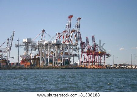 Port cranes at container terminal in port of Melbourne, Australia - stock photo