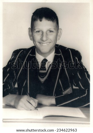 PORT ELIZABETH, SOUTH AFRICA - 1960's: A portrait of a young boy in his school uniform - stock photo