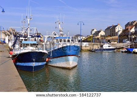 Port-en-Bessin is a commune in the Calvados department in the Basse-Normandie region in northwestern France. The commune contains the two towns of Port-en-Bessin and Huppain. - stock photo