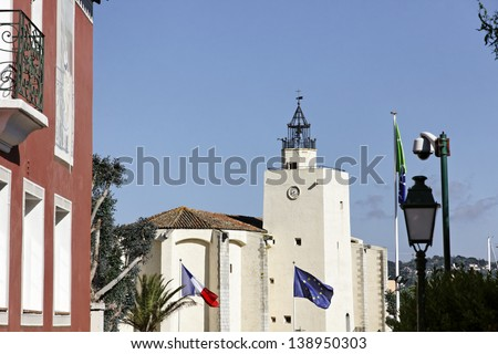 Port Grimaud, village church with a quadratic tower, Cote d'Azur, French Riviera, Southern France, Europe - stock photo