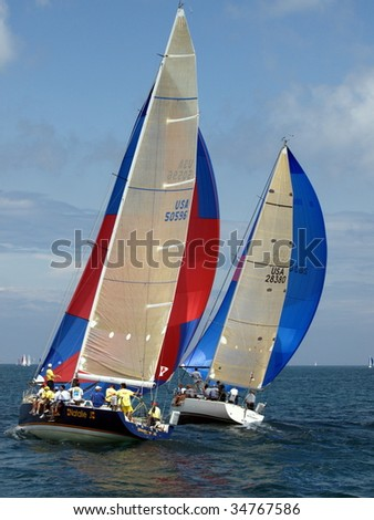 PORT HURON, MI - JULY 25: Participants sail away at the start of the Bayview Port Huron to Mackinac Race  July 25, 2009 in Port Huron, MI. - stock photo