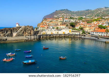 Port in fishing village Camara de Lobos on south coast of Madeira island  - stock photo