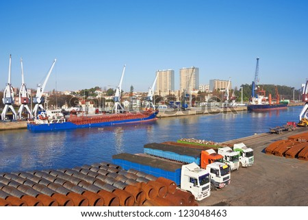 Port in Porto, Portugal, cranes and Large ships - stock photo
