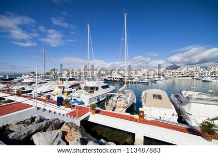 Port in Puerto Banus on Costa del Sol with luxury yachts, motorboats, powerboats, near Marbella in Spain. - stock photo