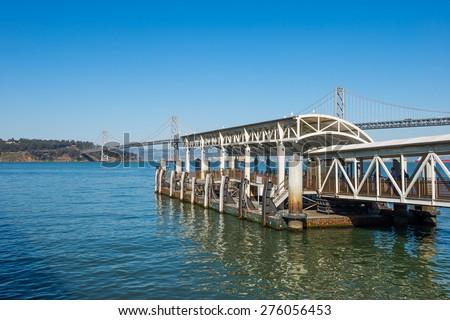Port in San Francisco Bay with Bay Bridge Background - stock photo