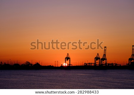 Port in the sunset - stock photo