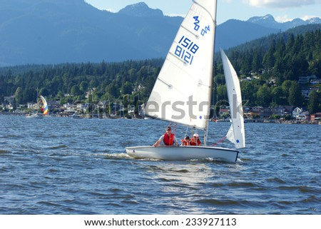 PORT MOODY, BC, CANADA - JUNE 2007: Family enjoying a sail on a summer day in Burrard Inlet, Port Moody, BC - stock photo