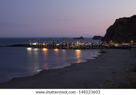 Port of Port Orford in Oregon at night. The only dolly dock on the Pacific Coast of the United States where the boats are launched and lifted with a crane. - stock photo