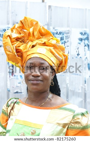 PORT OF SPAIN - AUGUST 1: Celebrating Emancipation Day which commemorates the abolition of Slavery August 1, 2011 in Port Of Spain, Trinidad & Tobago. Colorful & elaborate headpieces are usually worn. - stock photo