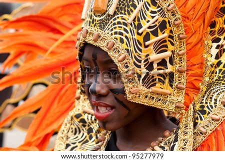 PORT OF SPAIN - FEBRUARY 11: Janessa Neptune portraying Swazi Queen  of Swaziland during the Red Cross Children's Carnival celebrations on February 11, 2012 in Port Of Spain, Trinidad & Tobago. - stock photo