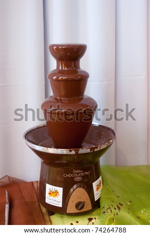 PORT OF SPAIN - MARCH 12: Chocolate Fountain on display at the L Edwin Annual Bridal Show at the Hilton Hotel March 12, 2011 in Port Of Spain, Trinidad & Tobago. - stock photo