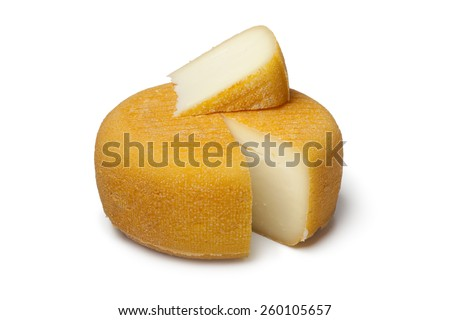 Port salut cheese with a slice on white background - stock photo