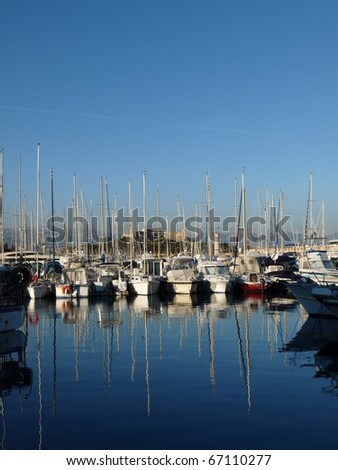 Port Vauban with the old town of Antibes is an attractive marina for yacht and boat. It is one of largest private and public marina along the Cote dâ??Azur, France - stock photo