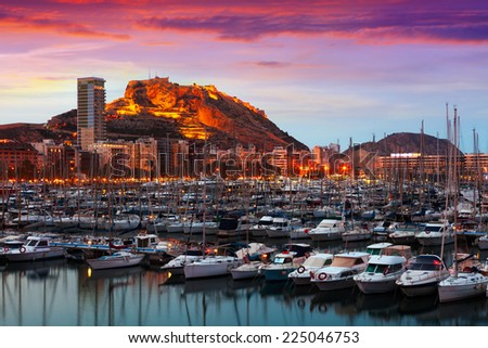 port with yachts against Castle of Santa Barbara in background during sunset. Alicante, Spain - stock photo