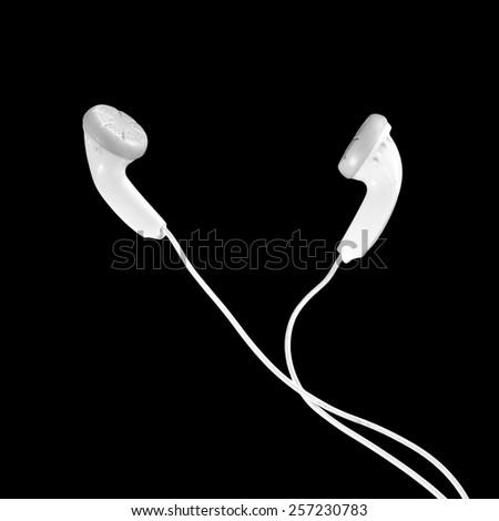 portable audio earphones isolated on black background - stock photo
